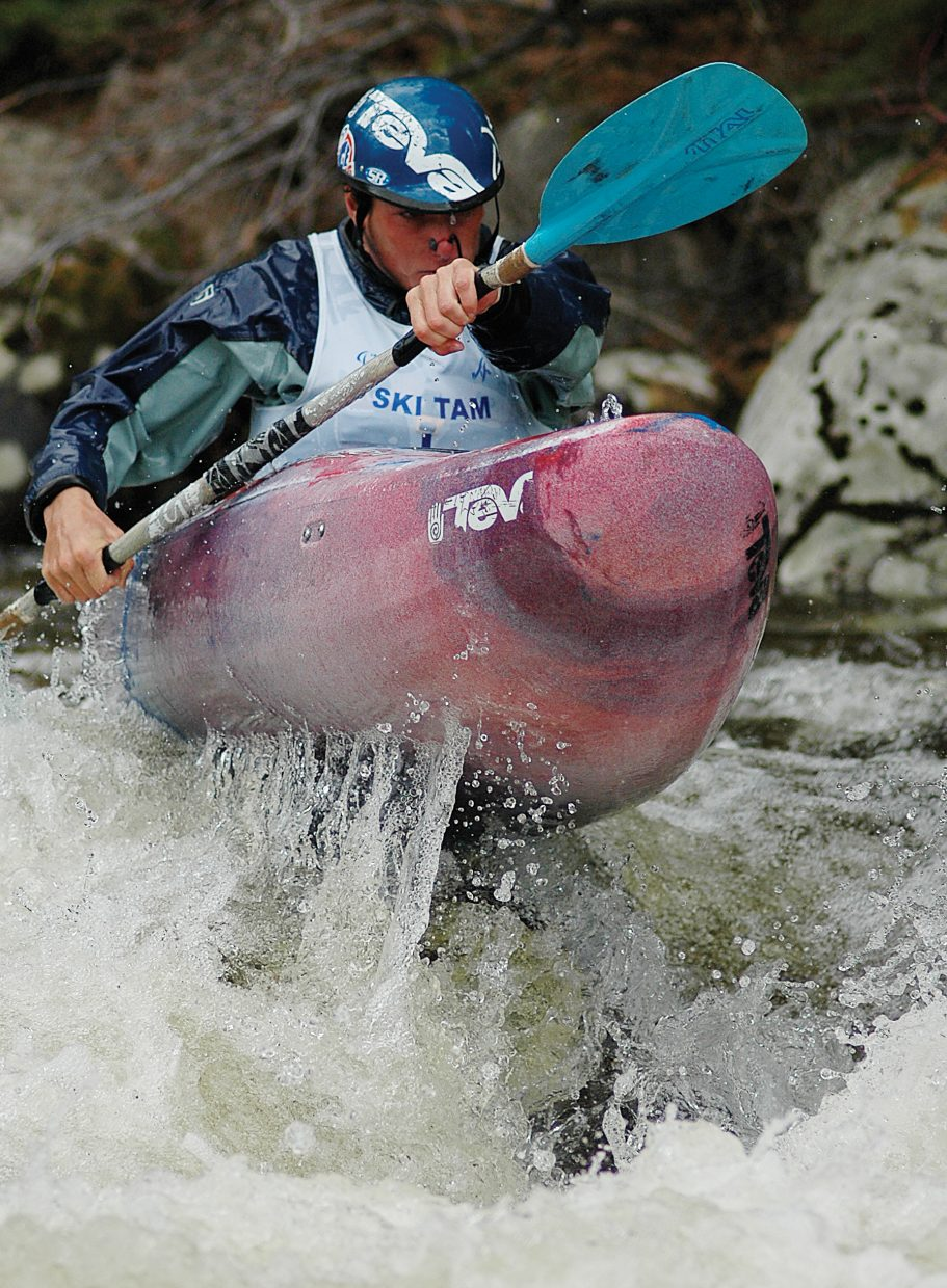 Tino Specht pushes over a boulder Monday during the Fish Creek race portion of the Paddling Life Pro Invitational. The creek race was moved to the afternoon to allow for more water in Fish Creek.