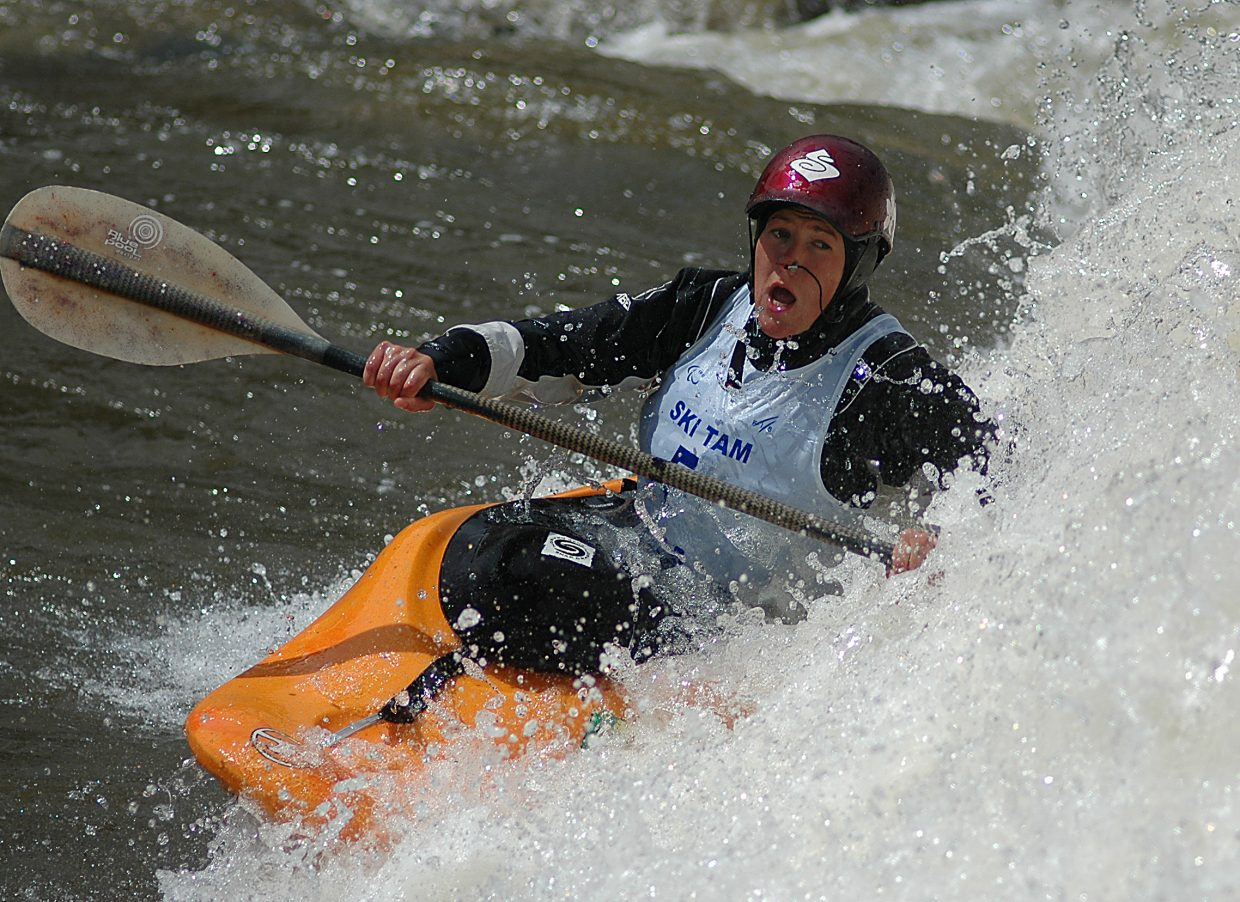 Sarah Hamilton slides toward the wave at Charlie's Hole on the Yampa River on Monday morning. Hamilton finished third in the freestyle portion of the Paddling Life Pro Invitational.