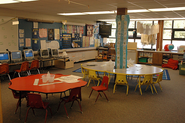 Many teachers at Soda Creek have made creative use of the support beams in the middle of their classrooms. In this kindergarten room, students sit in pods of tables wrapped around decorated poles.