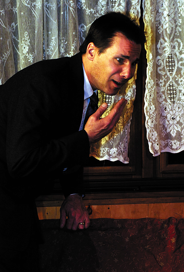 Mortimer Brewster (Matthew Stoddard) is shocked after discovering a body in the window box.