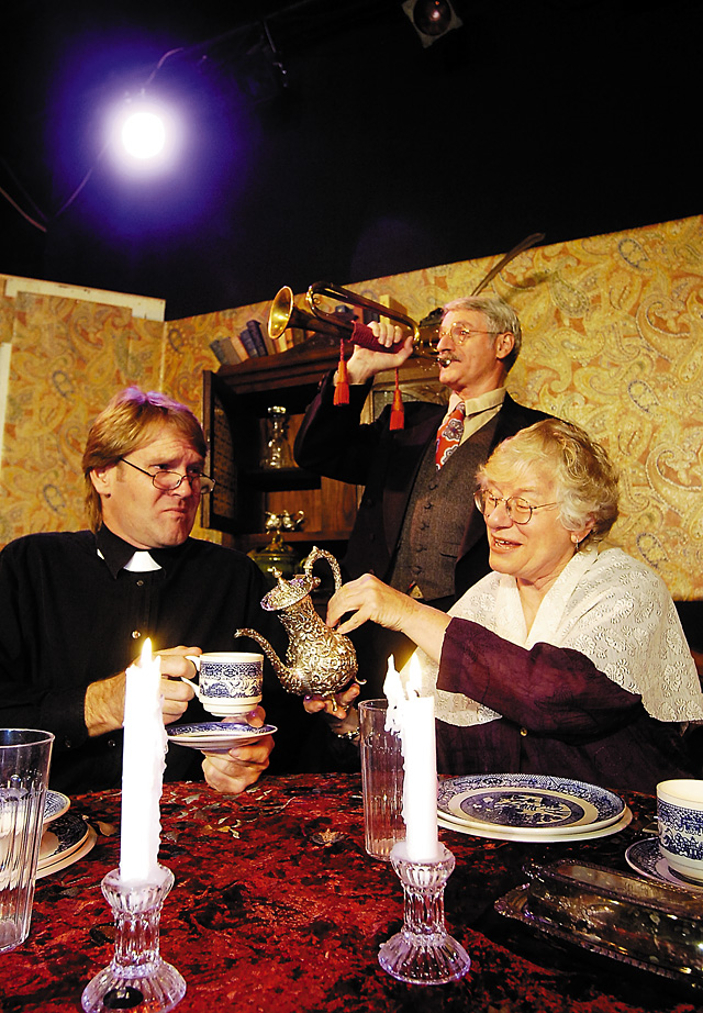 """Dr. Haper (Mark Bucksen) reacts to the noise created by Teddy Brewster (Cesare Rosati) while trying to carry on a conversation with Abby Brewster (Rusty DeLucia) in the dark comedy """"Arsenic and Old Lace"""" at the Steamboat Springs Mountain Theater."""