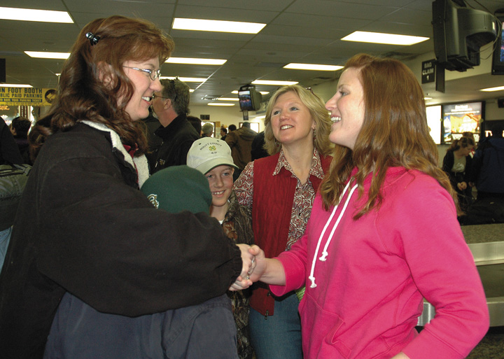 Rebekah LaDue, right, meets Shara Johnson after arriving Monday afternoon at Yampa Valley Regional Airport in Hayden. LaDue, who is in the Air Force, arranged to have an American flag flown over Iraq for Shara Johnson's son, Tyler, center. LaDue's mother, Cindy, and Tyler's sister, Tehya, facing away from camera, also greeted LaDue.