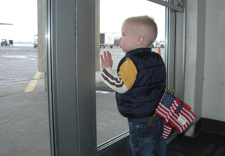 Lincoln Chaney, 18 months old, waits for the plane of his aunt Rebekah LaDue to touch down Monday at Yampa Valley Regional Airport in Hayden.
