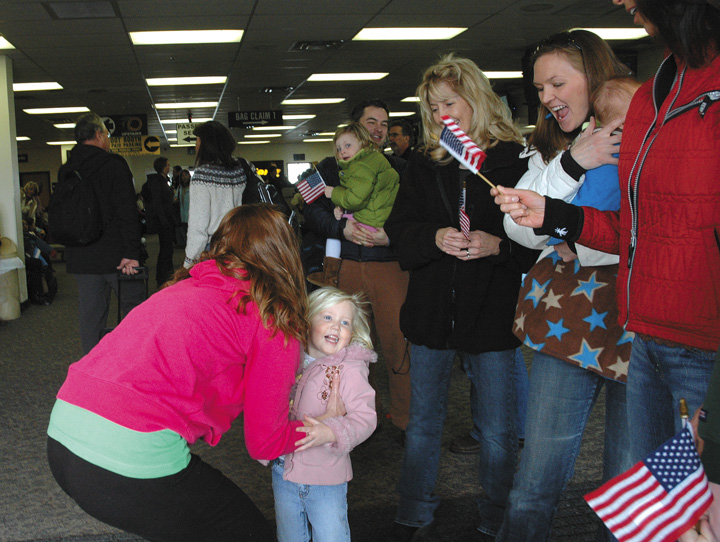 Rebekah LaDue, who returned to Hayden from Iraq on Monday, greets her niece Jaylah, 2. Judy Guerin, from center, Sarah and Ryle Chaney, and Brenda McKey also waited at Yampa Valley Regional Airport for LaDue.