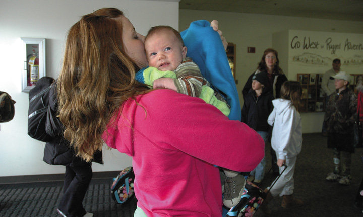 Rebekah LaDue meets her nephew Ryle Chaney for the first time Monday at Yampa Valley Regional Airport in Hayden. Ryle was born while LaDue was serving in Iraq with the Air Force.