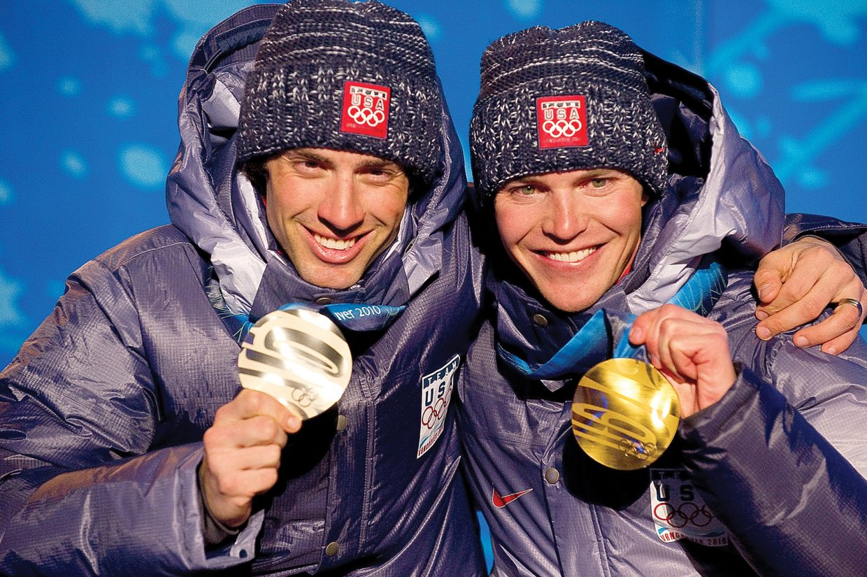 Olympic gold medalist Billy Demong, right, shares the stage at Whistler Olympic Celebration Plaza with his teammate Johnny Spillane. The pair dominated Thursday's large hill individual Gundersen event. Steamboat's Spillane, who was second in the normal hill individual Gundersen event Feb. 14, earned the silver to cap off the U.S. Nordic Combined Ski Team's best showing at an Olympics. The pair also earned silver in the Nordic combined team event Tuesday along with Brett Camerota and Todd Lodwick.