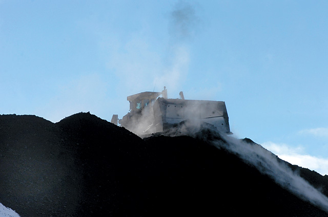 A bulldozer works on a mountain of coal at Twentymile Coal Co. near Steamboat Springs.