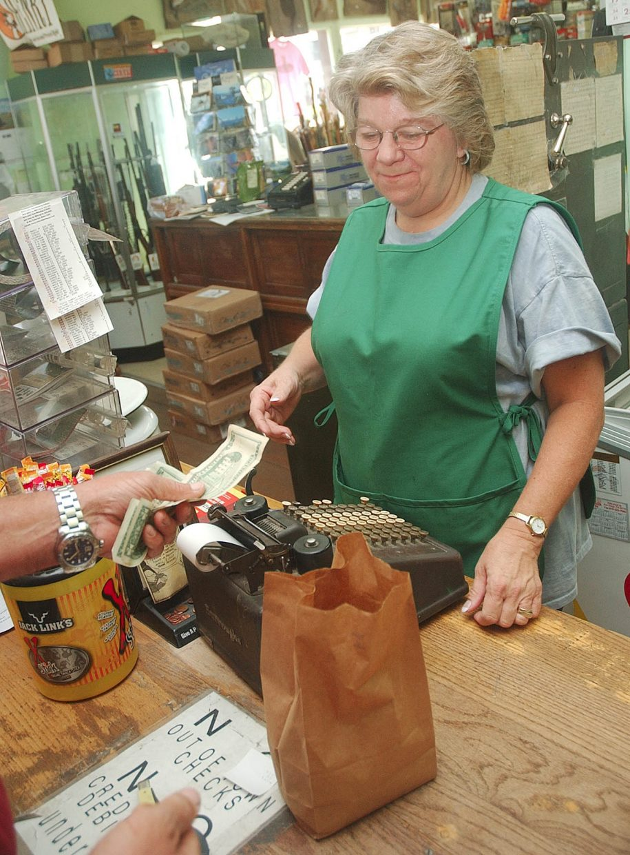 Cindia Montgomery checks out a customer Thursday at the store.