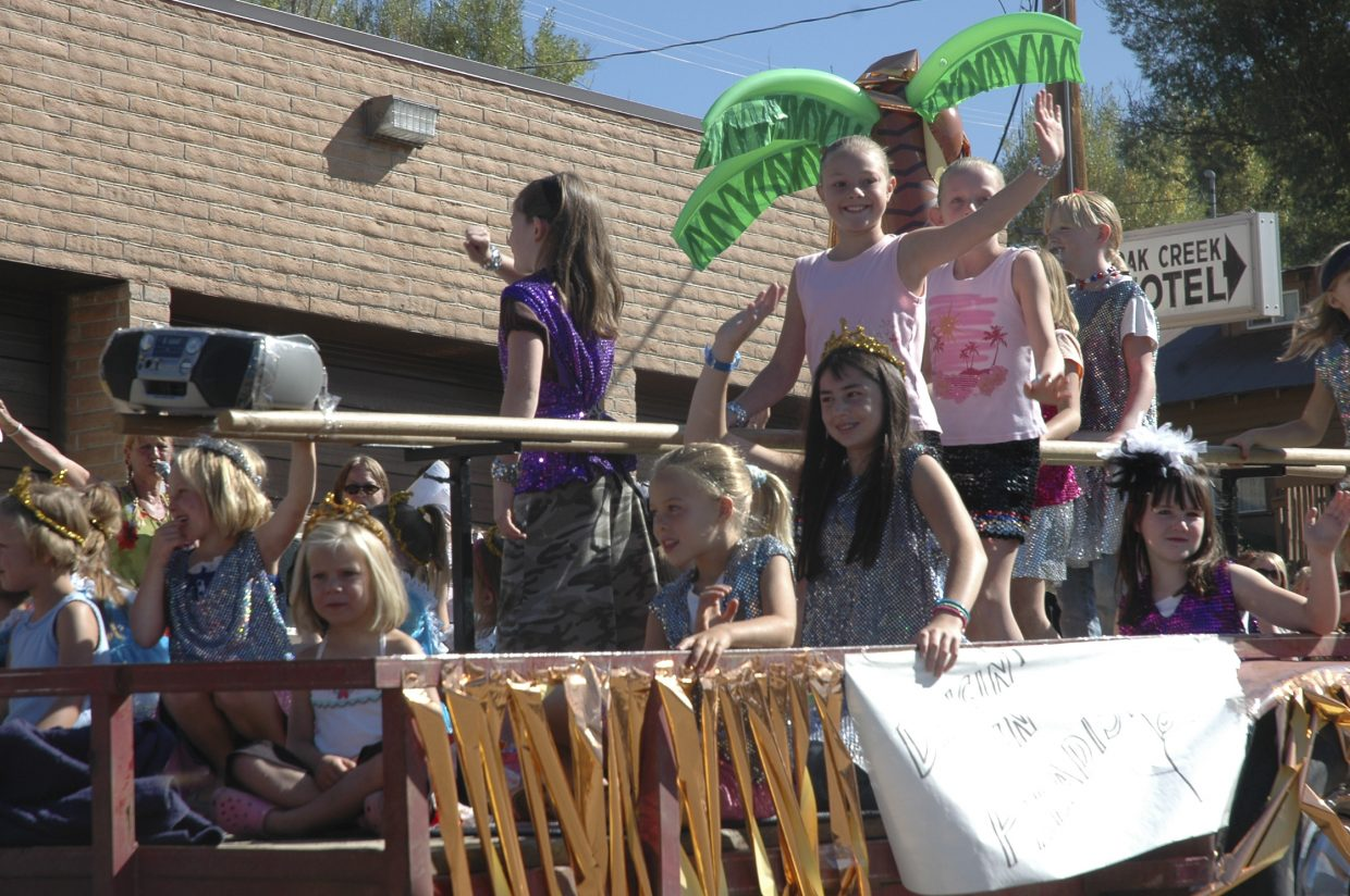 Members of Let's Dance Studio wave from their float during Oak Creek's Labor Day parade Monday.
