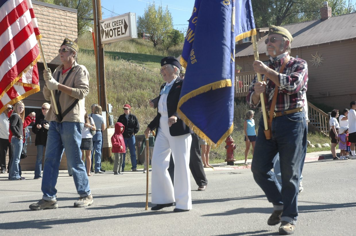 Veterans carry the flags during Oak Creek's Labor Day parade Monday.