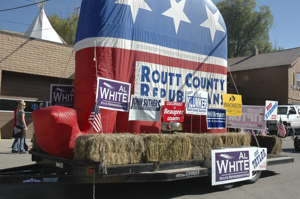 The Routt County Republicans float makes its way down Main Street during Oak Creek's Labor Day parade Monday.