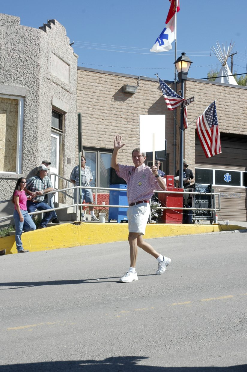 Gary Wall, the Democratic candidate for Routt County Sheriff, marches in Oak Creek's Labor Day parade Monday.