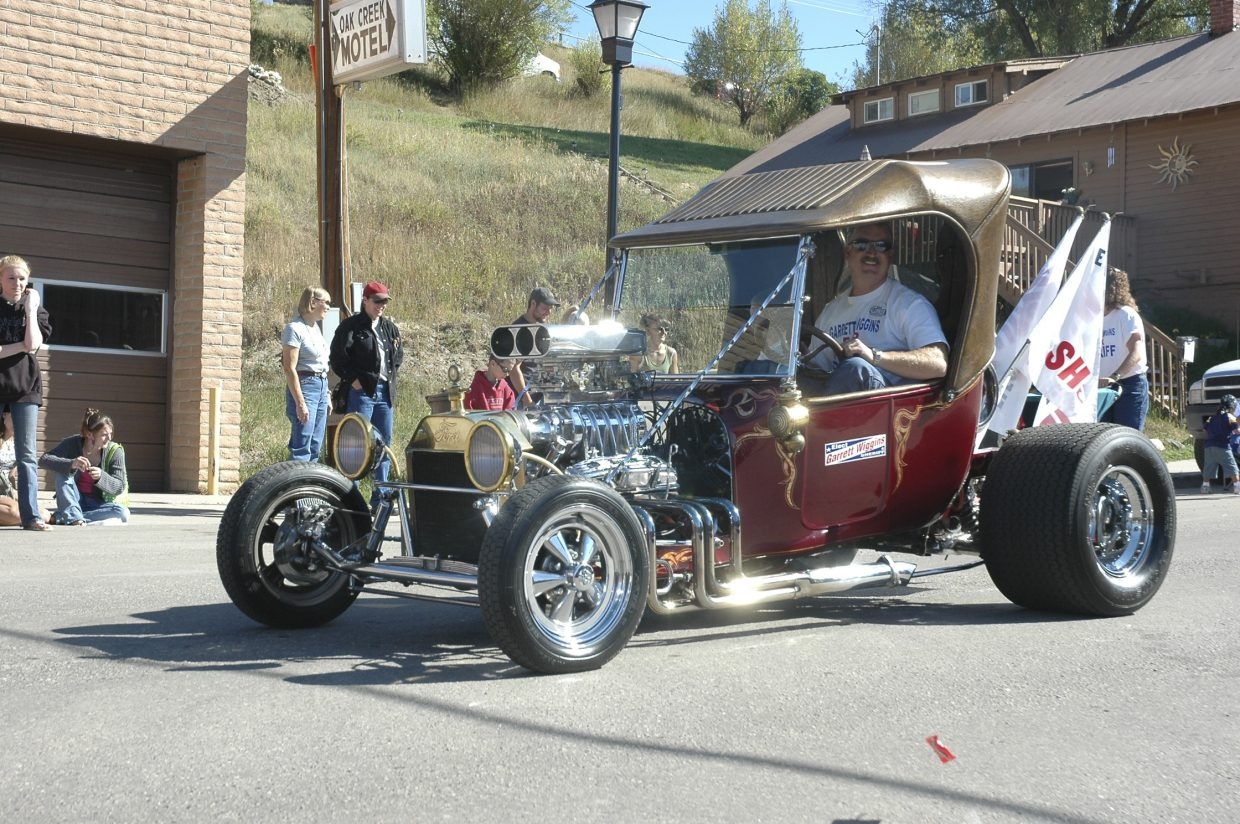 Garrett Wiggins, the Republican candidate for Routt County sheriff, rides down Main Street during Oak Creek's Labor Day parade Monday.