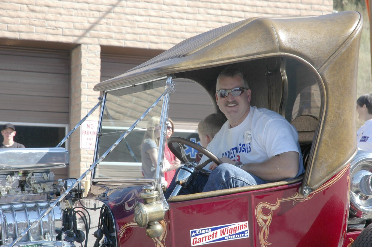 Garrett Wiggins, the Republican candidate for Routt County sheriff, drives in Oak Creek's Labor Day parade Monday.