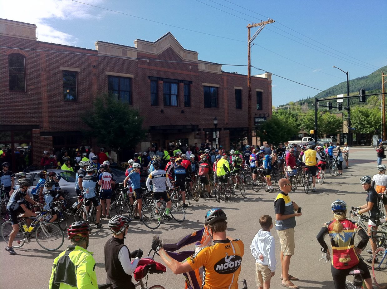 Cyclists wait outside Steamboat Ski & Bike Kare on Monday morning for a community ride with Andy Schleck, who finished second in the Tour de France.