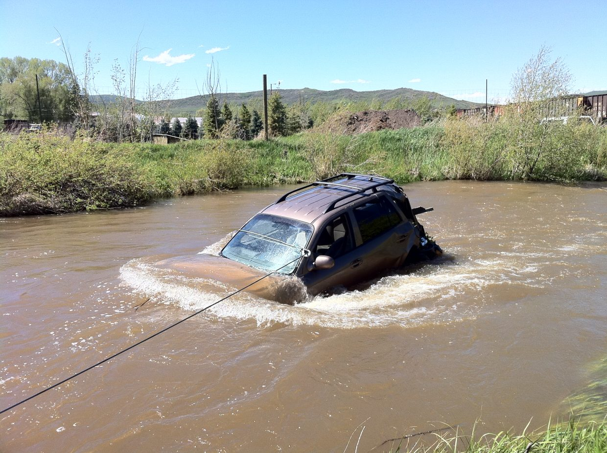 A woman driving north on Colorado Highway 131 south of Phippsburg left the road and hit a driveway and a tree before ending up in the Yampa River on Wednesday. She was taken to Yampa Valley Medical Center with injuries.