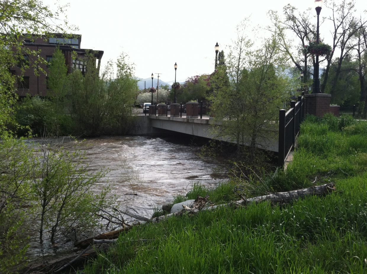 The Yampa River remained high at the Fifth Street Bridge on Sunday.