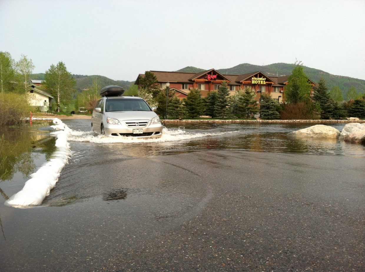 High waters remained at the Steamboat Hotel parking lot Sunday.