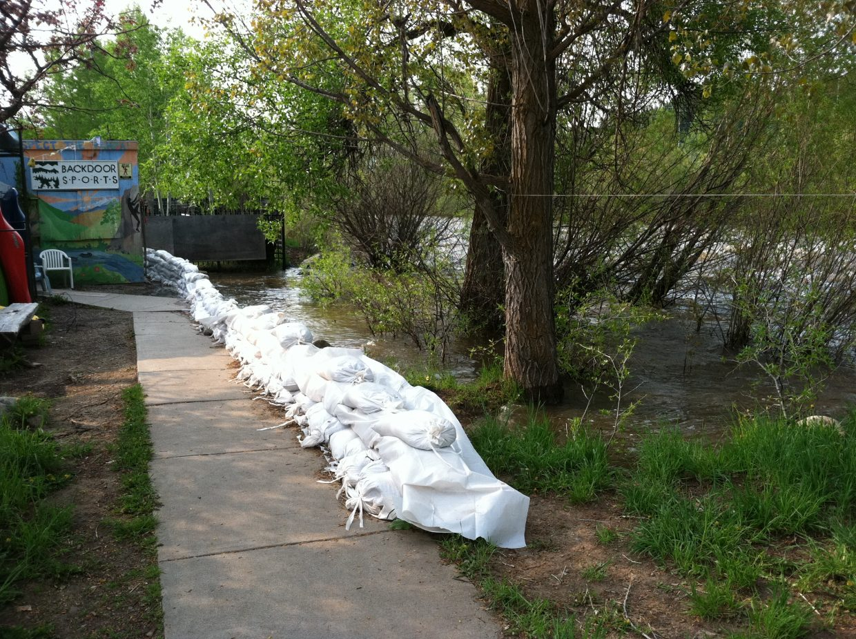 The waters of the Yampa River continued to creep up behind Backdoor Sports on Sunday.