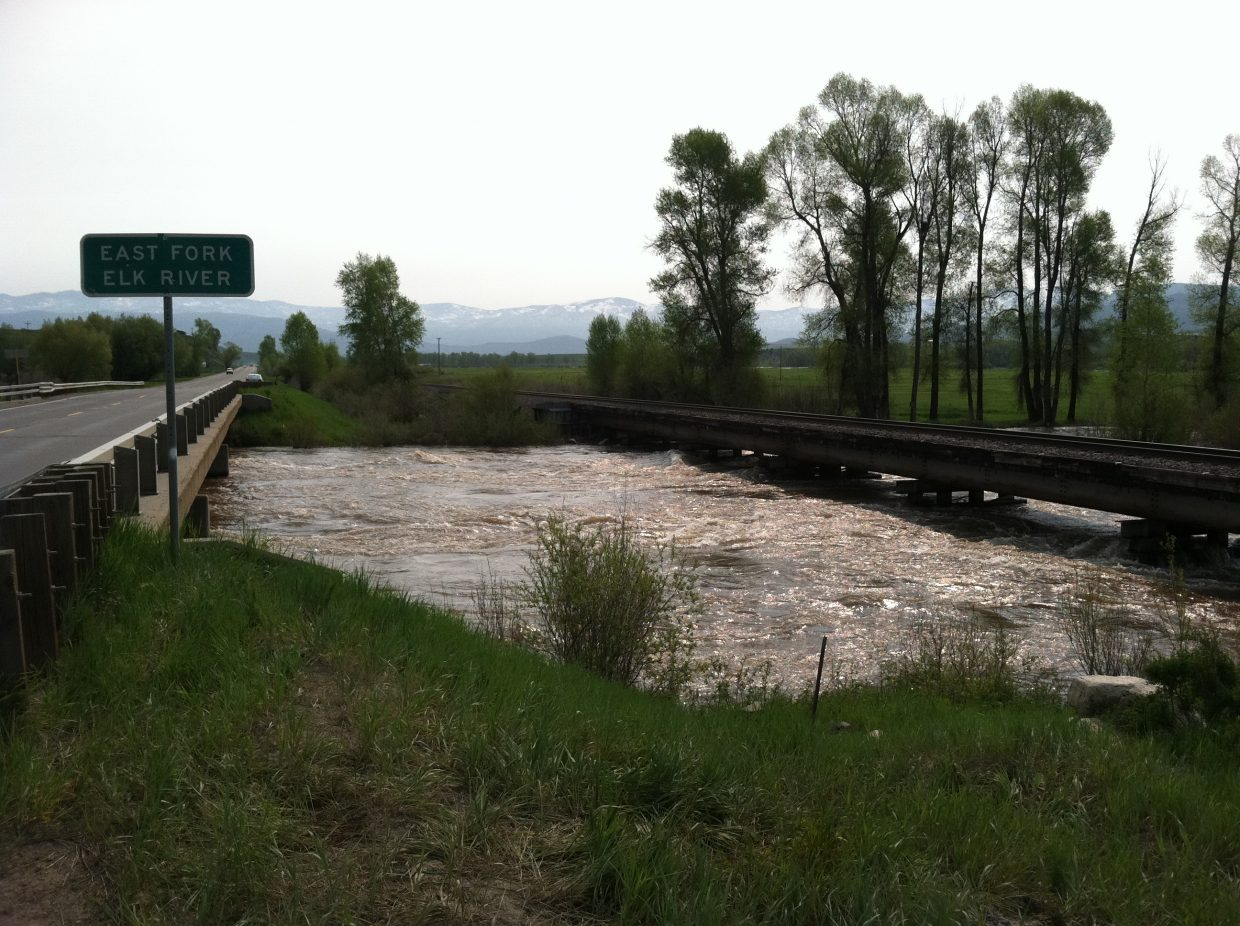 The Elk River nips at the railroad bridge Sunday outside of Steamboat Springs, about a half-mile east of Routt County Road 44.