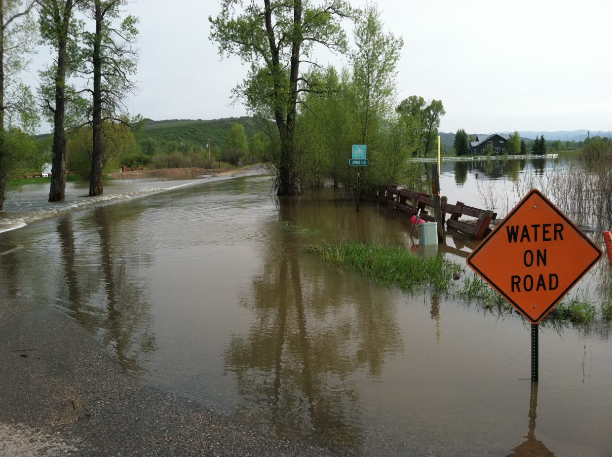 Waters surged Sunday at the Elk River at Routt County Road 44.