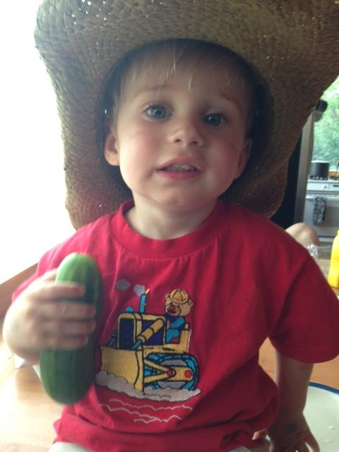 Simon Cates and Twisted Oak Gardens' first cucumber of the summer. Submitted by: Cati Ellis.