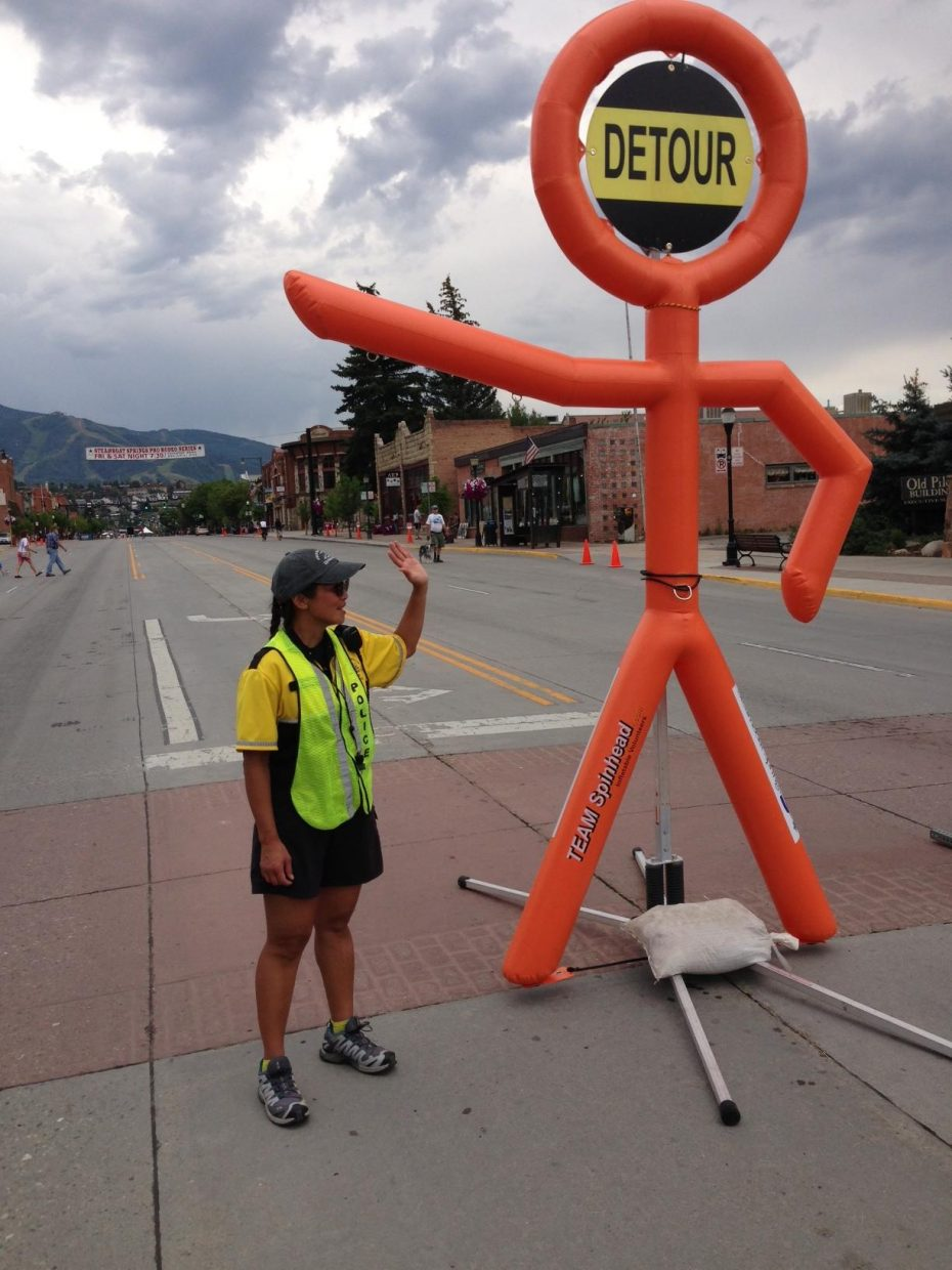 Maria helps set up for the USA Pro Challenge. Submitted by: Craig Canon