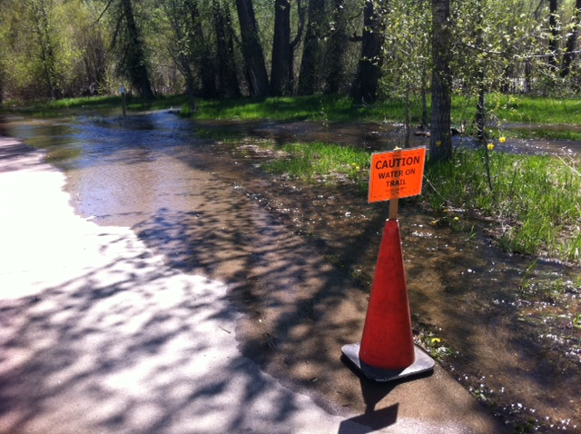 Water warnings were posted along the Yampa River Core Trail on Thursday. The river is expected to continue to rise.