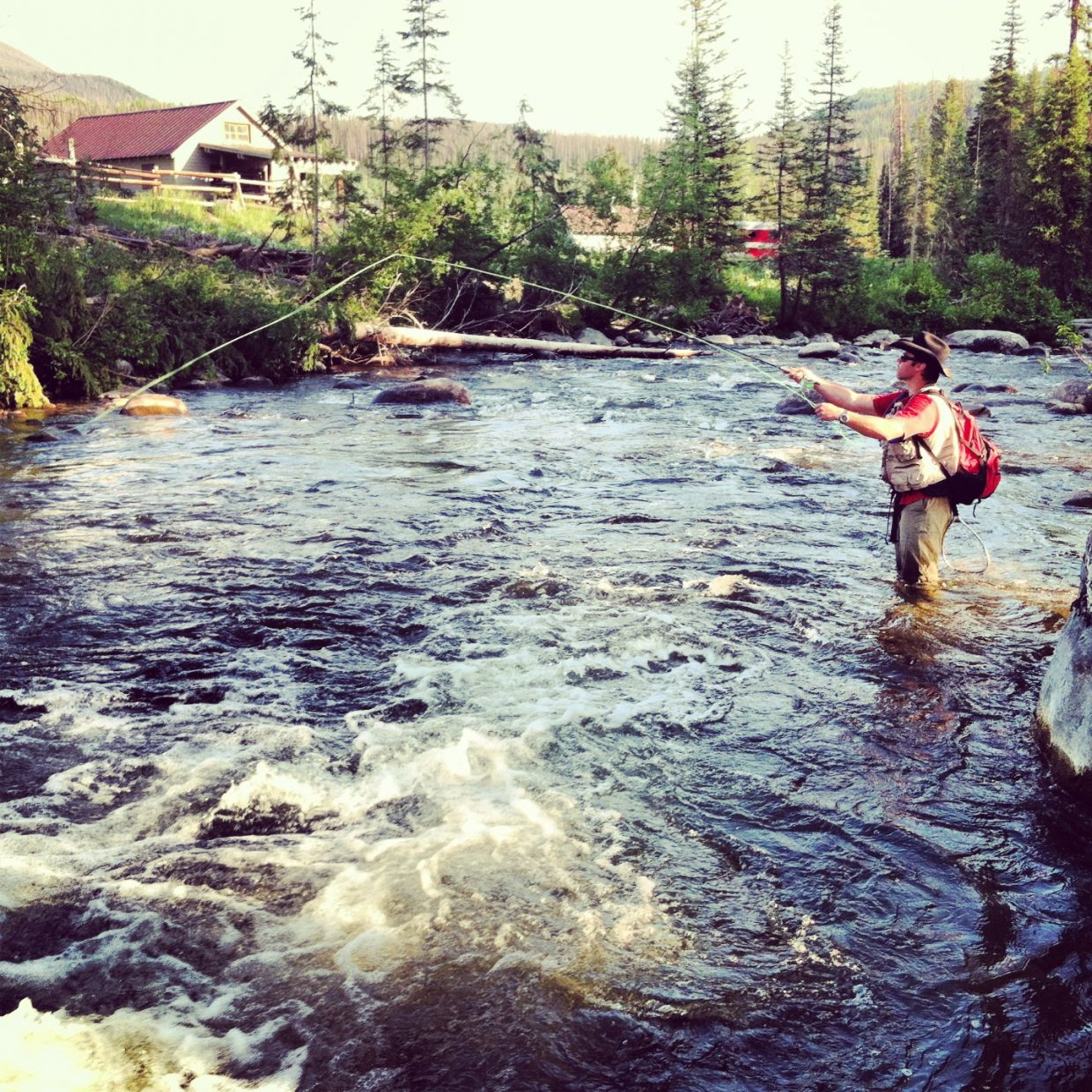 Ben Holdridge fishing. Forest ranger station in the back ground up Diamond Park. Submitted by: Shara Ludlum