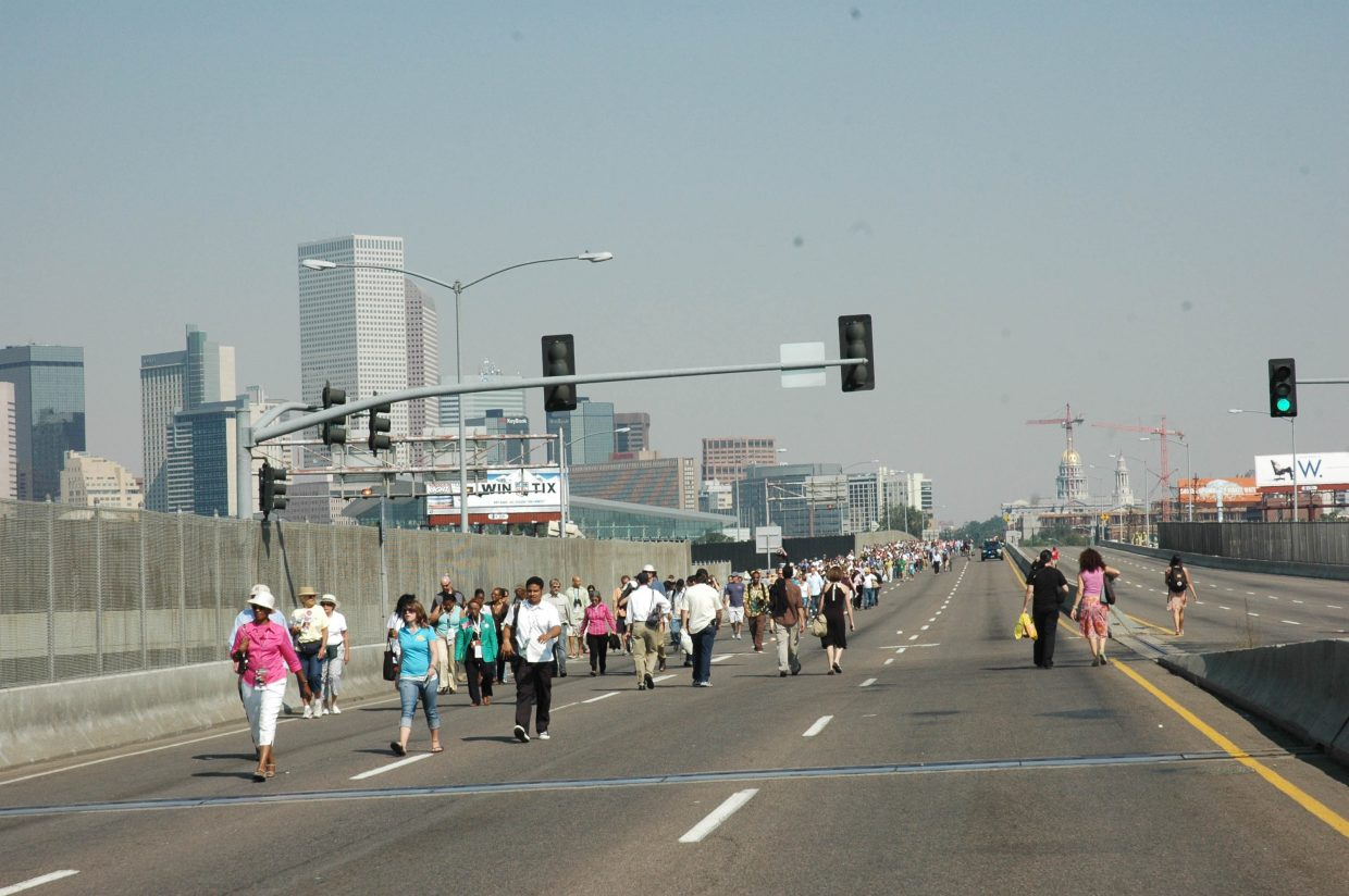 The line of people walking to Invesco Field on Thursday, to see Barack Obama accept the Democratic nomination for president, stretched far along Colfax Avenue, where protestors thronged closer to the stadium.