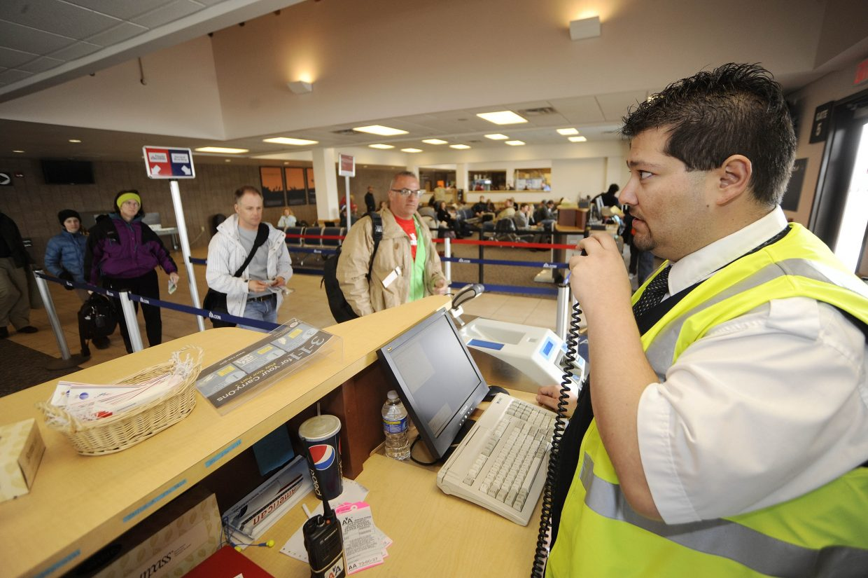 Yampa Valley Regional Airport gate agent Charles Anaya makes an announcement while boarding a flight Friday.