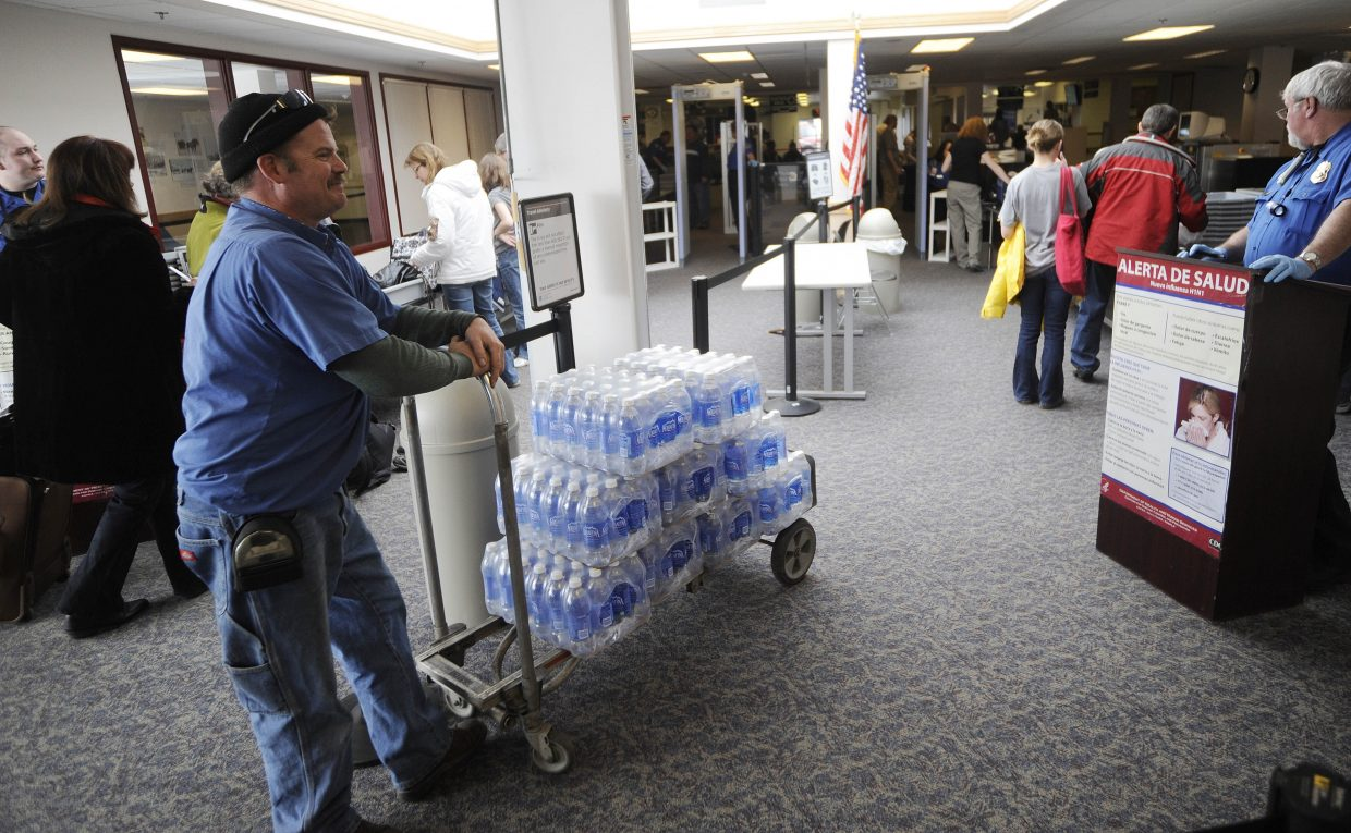 Pepsi driver Eric Nehring waits in security to make a delivery at the Yampa Valley Regional Airport on Friday.