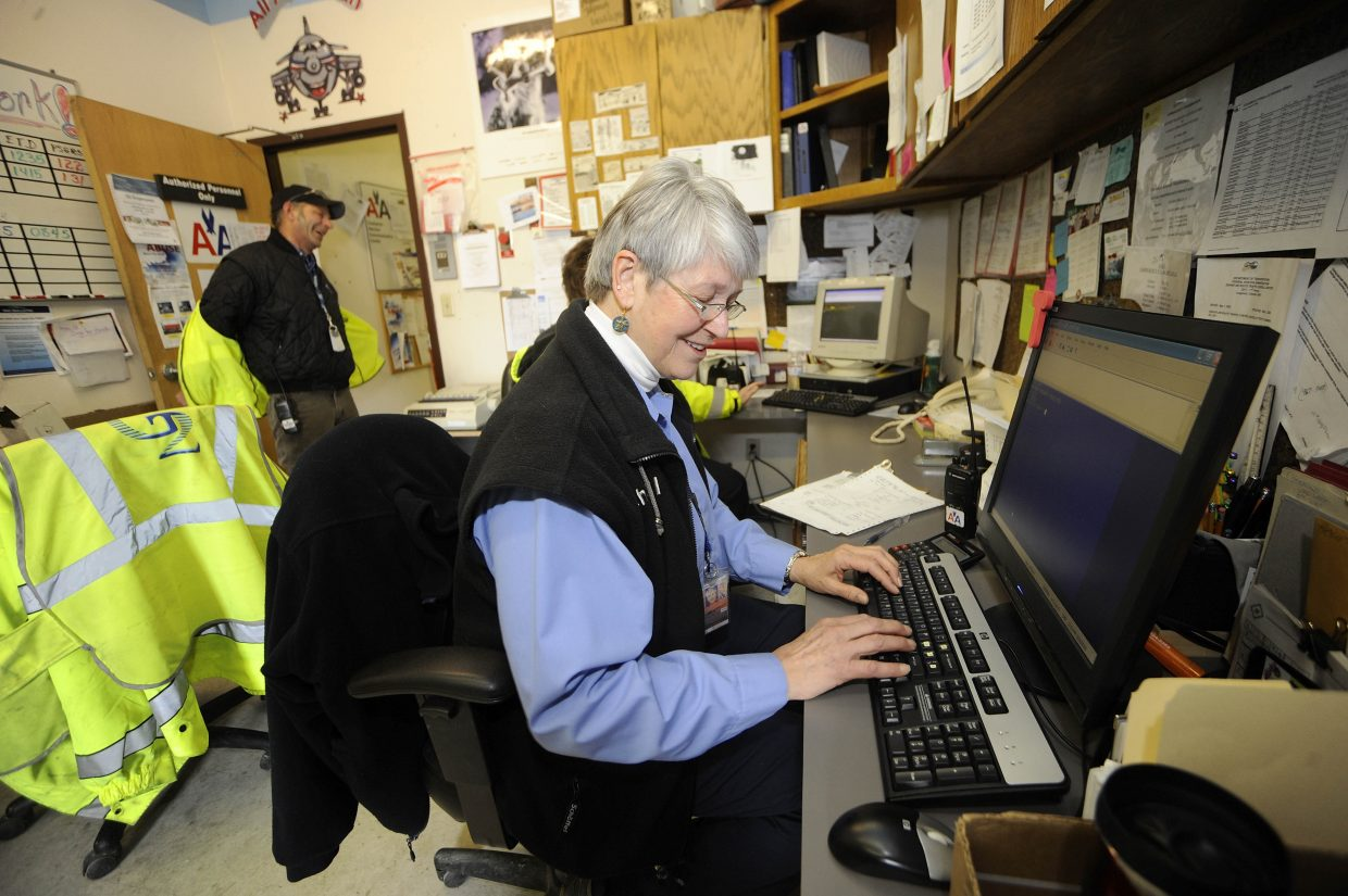 American Airlines operations worker Kay Wagner works in the operations room Friday at Yampa Valley Regional Airport.