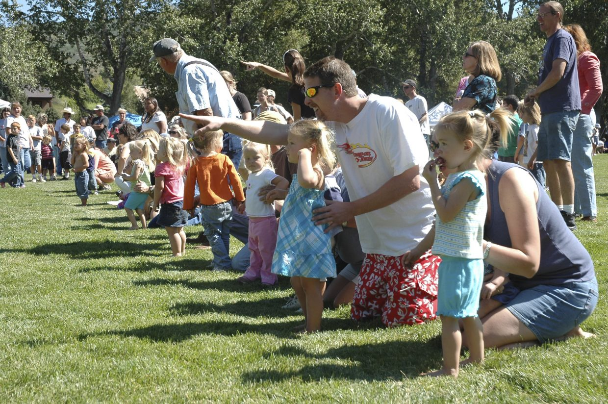 Girls ages 2 to 4 line up for a race at Decker Park during Oak Creek's Labor Day celebration. Children competed in races based on age groups, and winners were awarded candy and prizes.