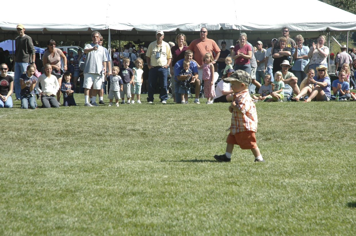 A 1-year-old Oak Creek boy races to win candy during the town's Labor Day celebration Monday.