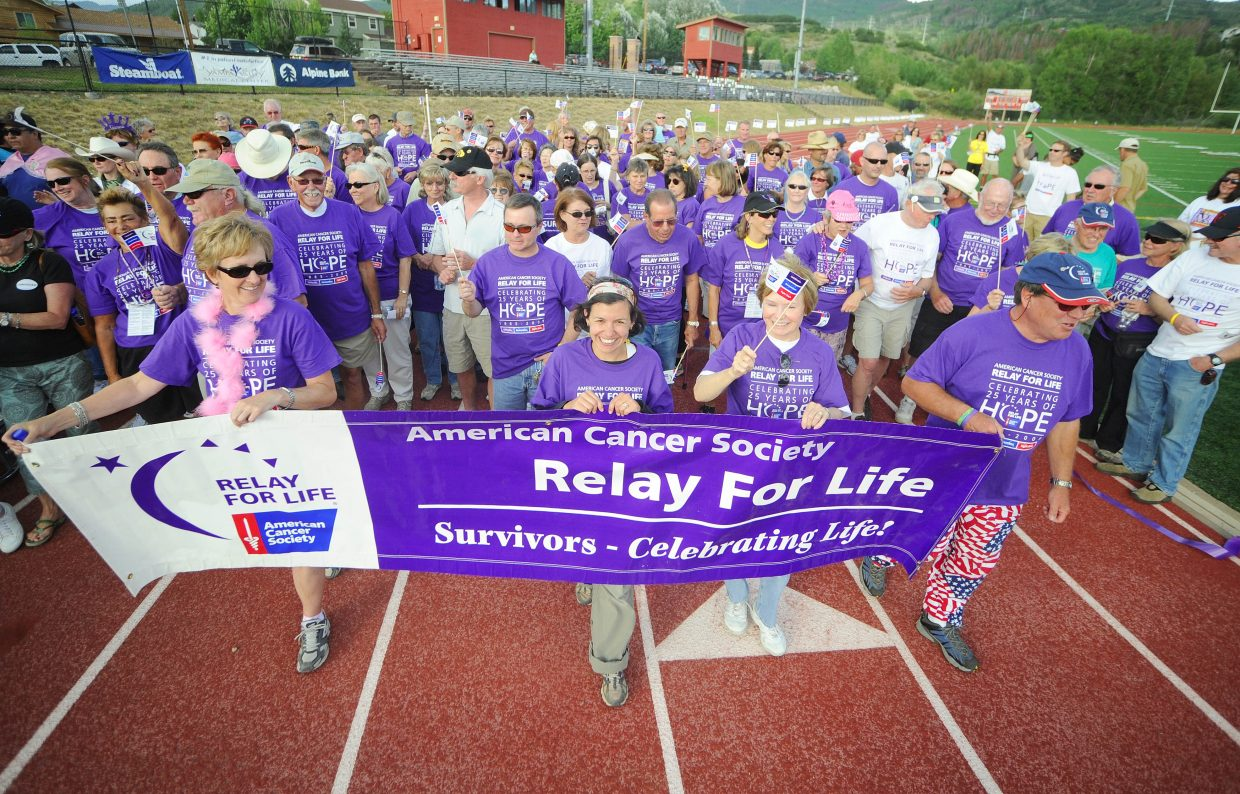 Cancer survivors begin the Survivor's Lap on Friday at the fourth Relay For Life in Steamboat.