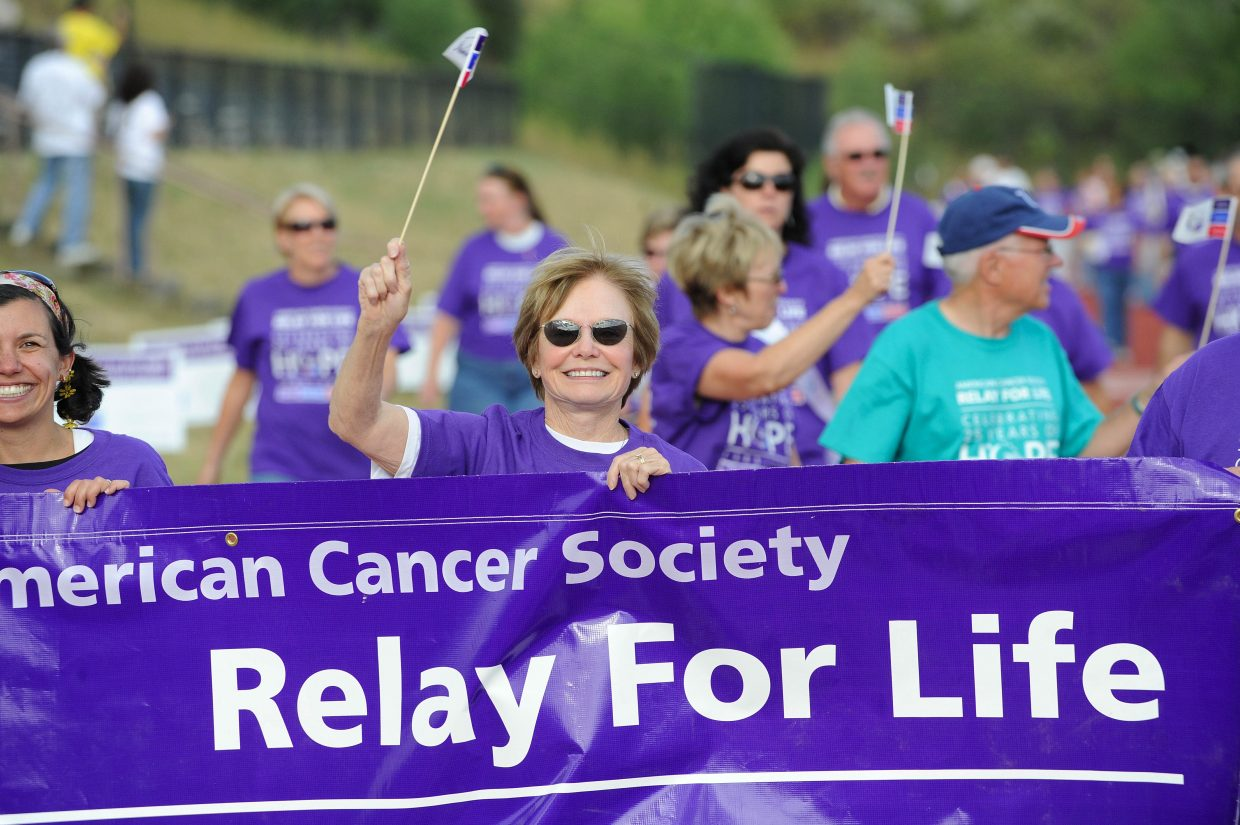 Part-time Steamboat Springs resident Doris Ross waves a flag while walking in the Survivor's Lap.