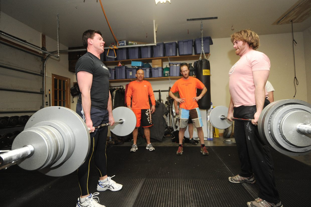 Michael Hurley, left, and Chris Cole perform deadlifts.