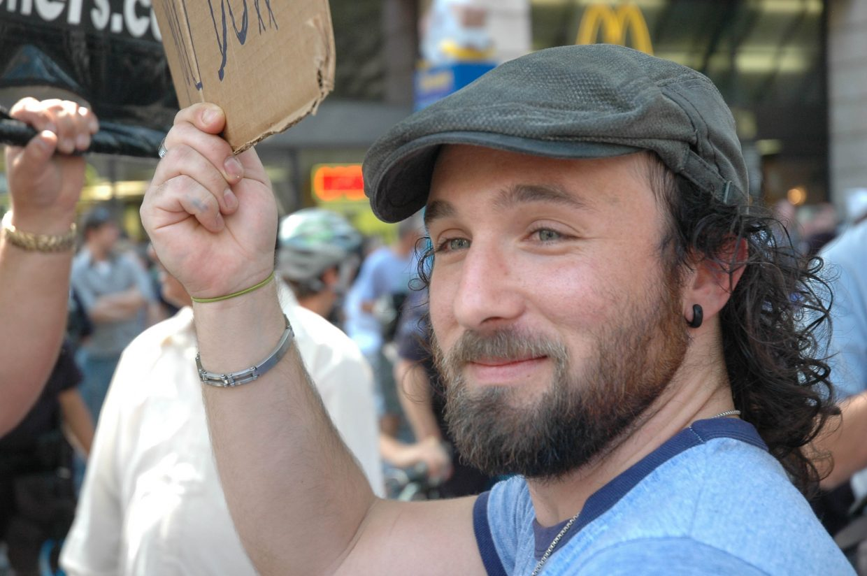 Grant Bennett of Los Angeles protests the Open Air Preachers group Monday on the 16th Street Mall.