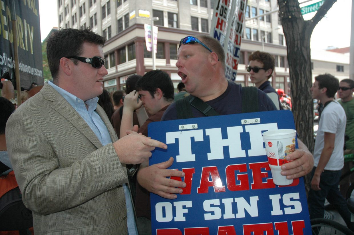 Ben Malloy of Stanford, Conn., argues with Timmy Schultheis of Open Air Preachers. The sidewalk preachers drew angry crowds with their denouncement of homosexuality on the 16th Street Mall in Denver on Monday.