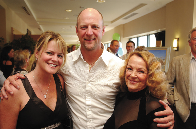 Carpenter's Ball volunteer fundraising coordinator Connie Livengood, right, with Kenny and Holly Day, owners of Triple 555 Ranch Design and Travel.