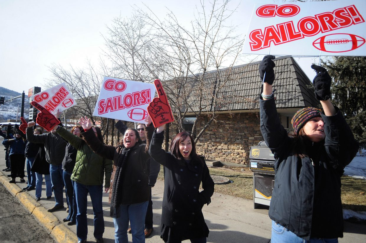 Wells Fargo employees take a break from work to send off the Steamboat Springs High School football team Friday afternoon.