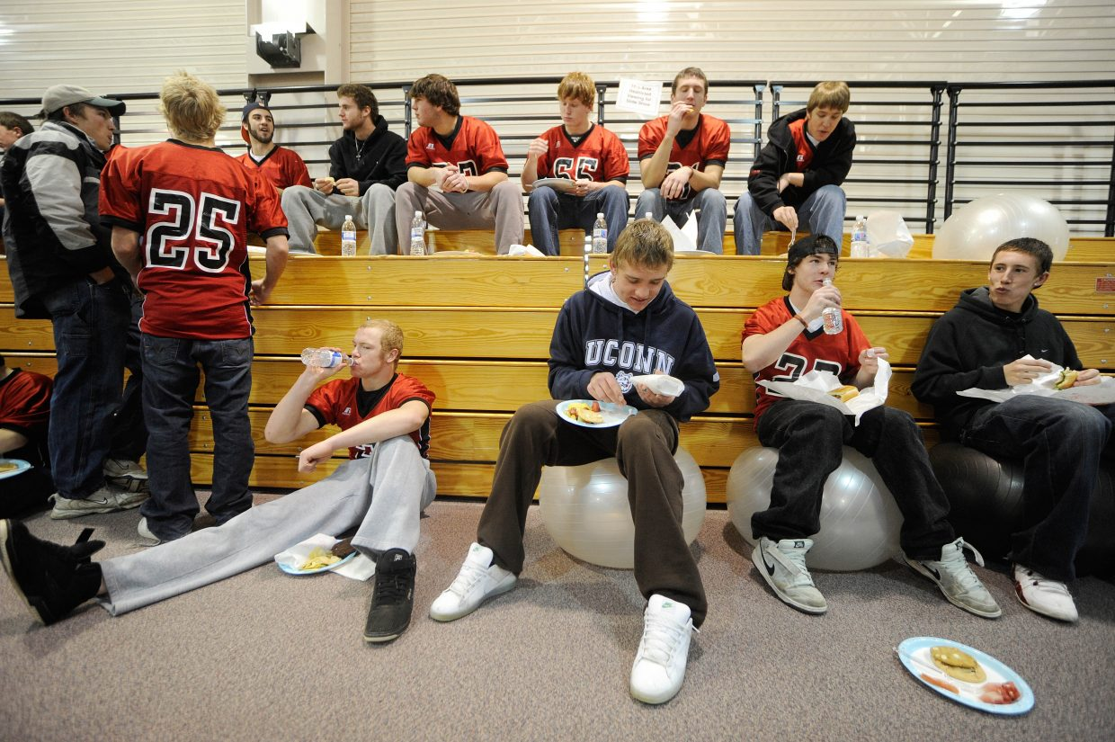 Steamboat Springs High School football players have lunch in the gym before leaving for today's state championship game in Aurora.