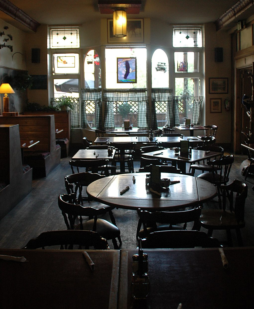 Sun comes in through the large windows at the front of Black Mountain Tavern in Oak Creek on a slow afternoon in July. Doug Diamond sold the restaurant on Aug. 1, citing the poor economy.