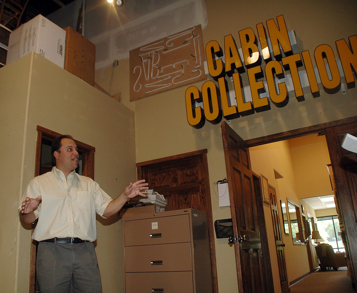 Michael Buccino, owner of Steamboat Interiors, explains how he saved thousands of dollars and likely his business by drastically scaling back the scale of his operation. In its heyday several years ago, he opened Cabin Collections to sell high-end furniture from an east Steamboat Springs storefront. He eventually closed the business, though its sign still hangs in his scaled-back warehouse.