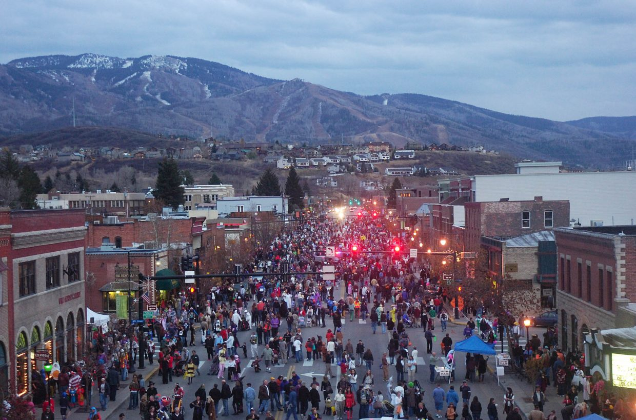 A view from the ladder of a Steamboat Springs Fire Rescue truck shows locals filling Lincoln Avenue dressed in costumes during the 2018 Downtown Halloween Stroll.