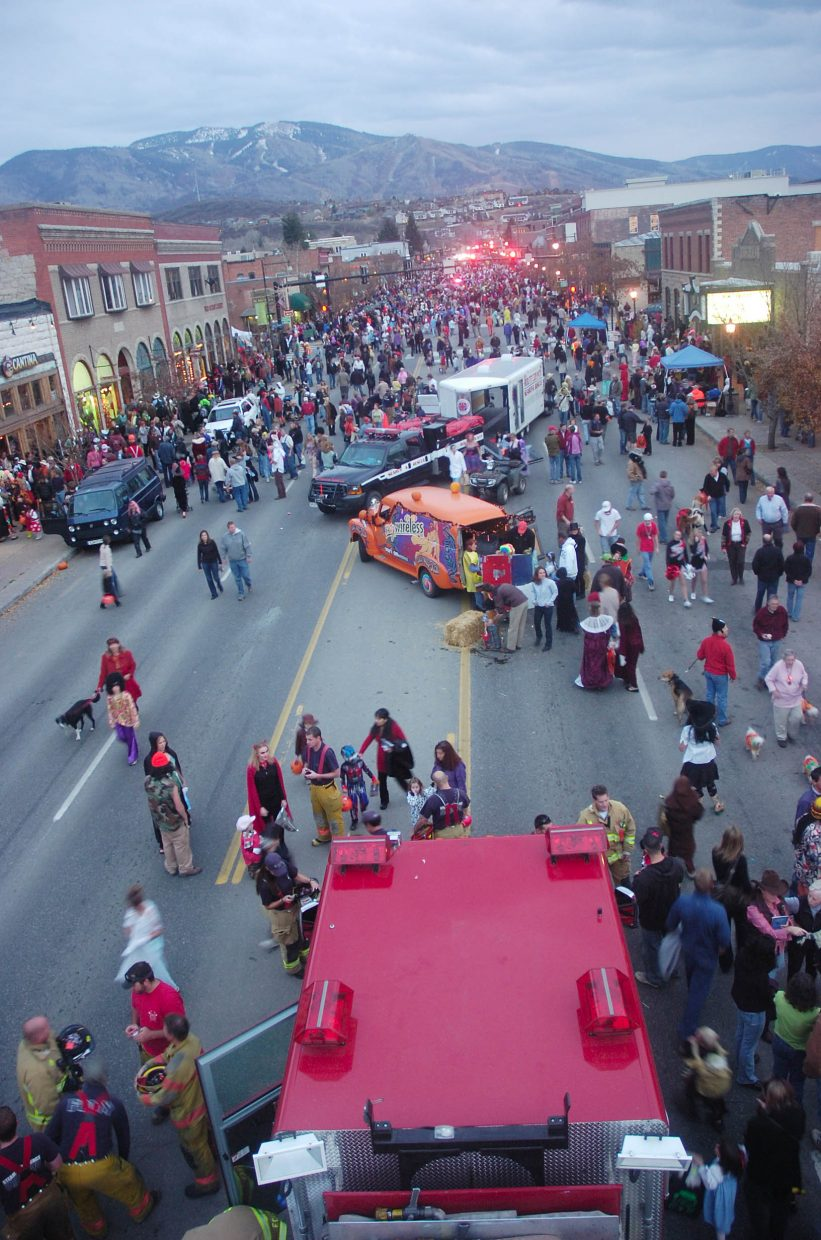 Locals fill Lincoln Avenue on Friday night, dressed in costume during the annual Downtown Halloween Stroll.