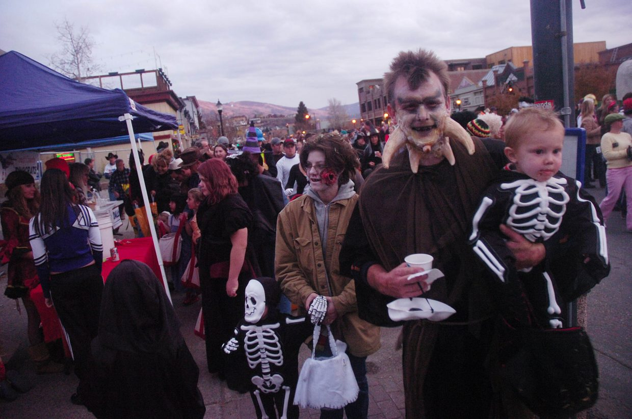 The David family, of Steamboat Springs, from right, Danny, Max, Robin and Preston participate in Friday's Downtown Halloween Stroll.