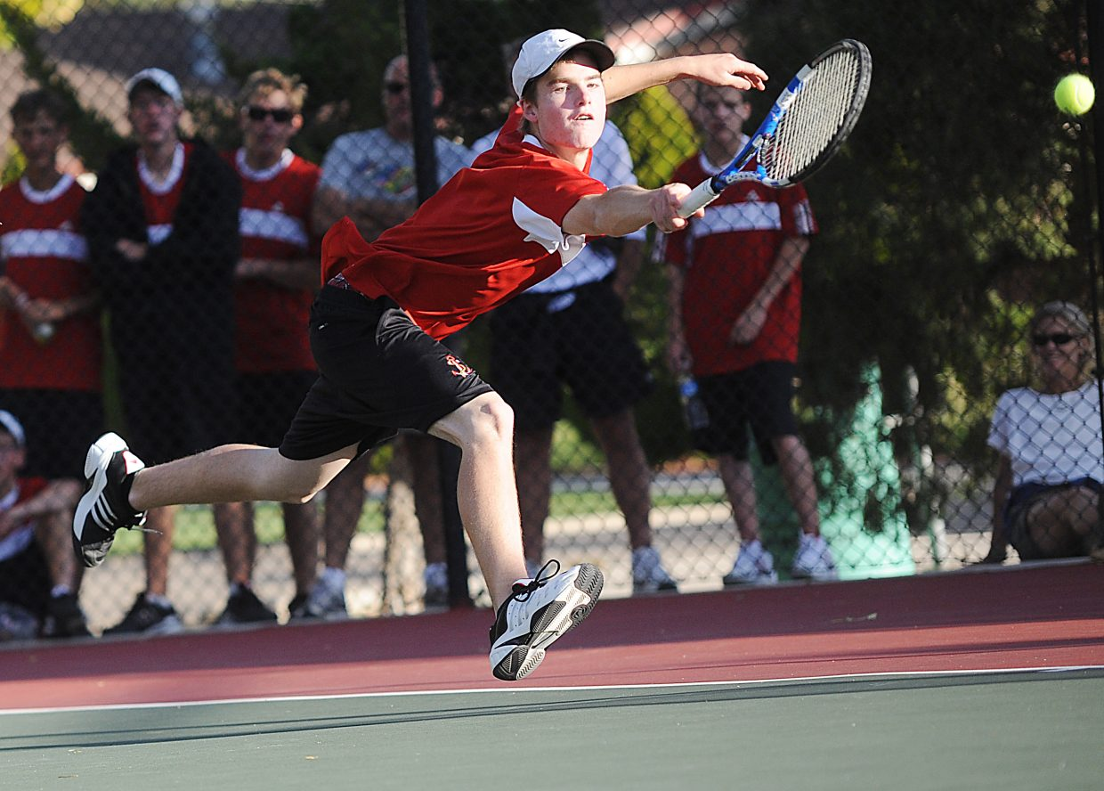 Luke Farny leans to return a ball Thursday at the state tennis tournament in Pueblo.