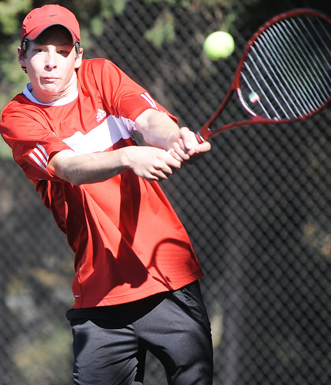 Jamey Swiggart swings for a ball Thursday at the state tennis tournament in Pueblo.